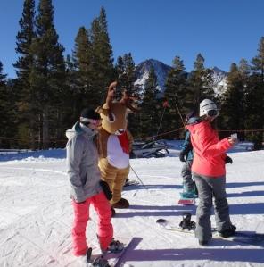 June Mountain photo of children and reindeer.